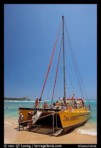 buy a boat oahu picture photo catamaran landing on waikiki beach waikiki