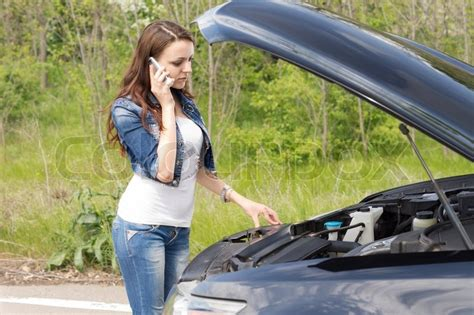 woman driver on the phone for car breakdown beautiful young woman driver calling for breakdown