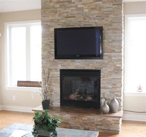 split fireplace with tv modern family room