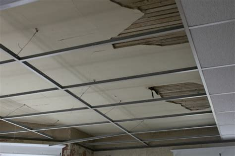 A Damaged Ceiling Repair Or Replace Replacing Drop Ceiling