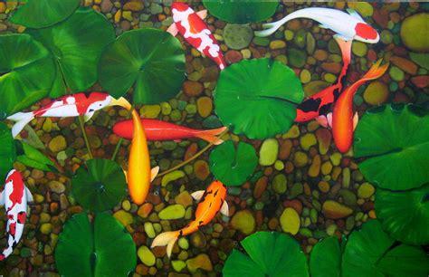 koi fish in pond by sabaiporn wonganu