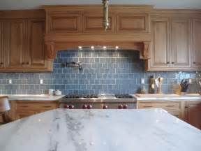 Blue Kitchen Tile Backsplash tile maple kitchen cabinets marble countertops pot filler and blue