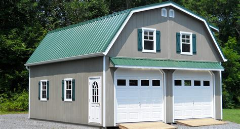 Car garage with gambrel metal roof and awning