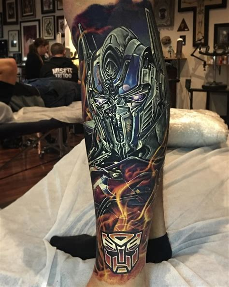 optimus prime tattoo by ben kaye