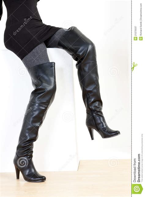 wearing boots wearing black boots royalty free stock photography