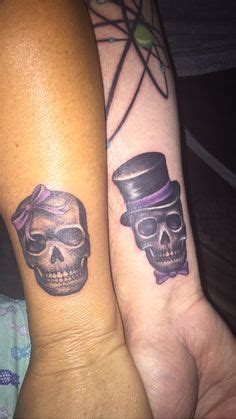 matching skull tattoos couples on back of ankle tattoos
