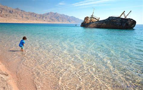 Saudia Pelangi wanderlust in saudi arabia haql shipwreck blue abaya