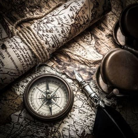 sextant compass vintage still life with compass sextant and old map photo