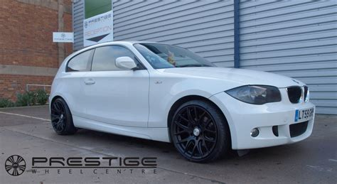 bmw 1 series with black alloys 3sdm 0 01 alloy wheels refinished in satin black on this