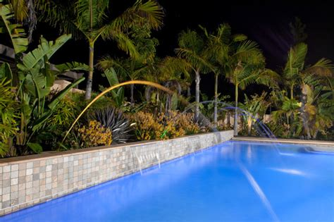 Pool And Outdoor Kitchen Designs Tropical Style Planting Behind Pool Tropical Landscape
