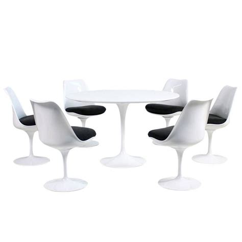 Tulip Table And Chairs by 1960s Eero Saarinen Tulip Dining Table And Six Swivel