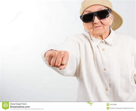 cool stock cool grandma kicks with her fist stock photo image 45372085