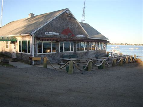 dolphin restaurant with potts cove in background picture