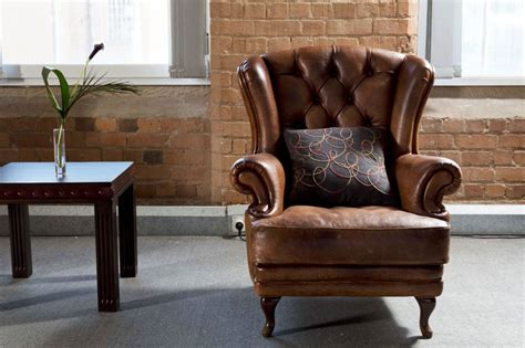 armchair in living room brown leather sofa and armchair infosofa co