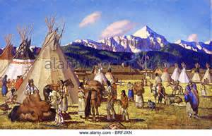Blackfoot indians bring furs to a trading post stock image