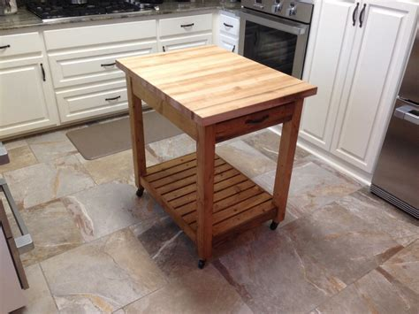 small kitchen island with cutting board by
