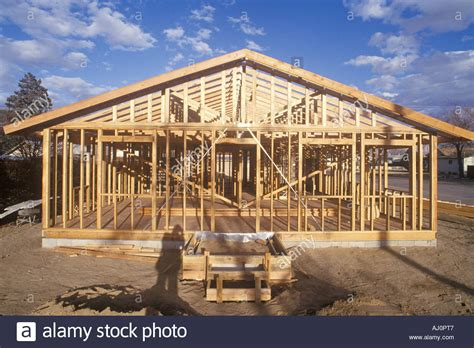 buying a house under an llc wood frame of house under construction lone pine ca stock photo royalty free image