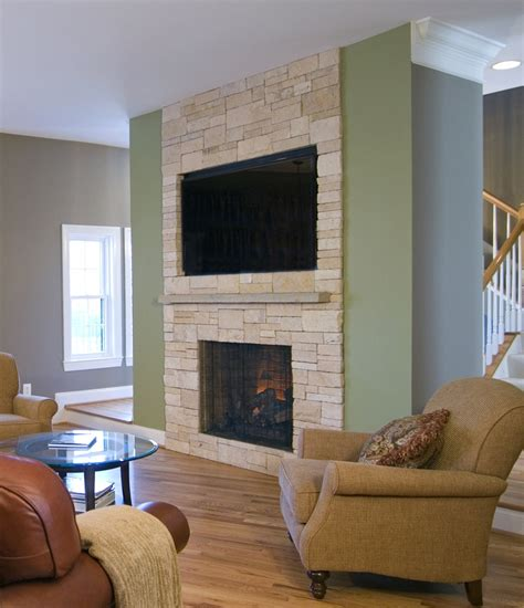 engineered stone surround this tv niche and gas fireplace