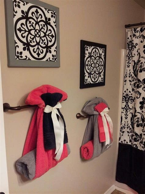 cute way to hang towels for guest bathroom home