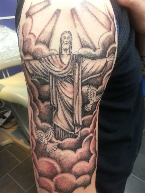 christ the redeemer tattoo jesus in the clouds