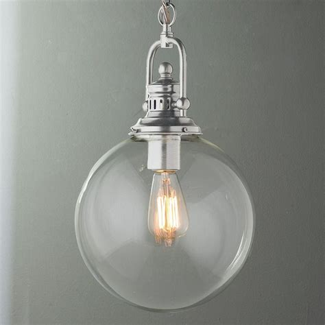 Clear Globe Pendant Light Clear Glass Globe Industrial Pendant A Clear Glass Globe Is Suspended From Industrial Inspired