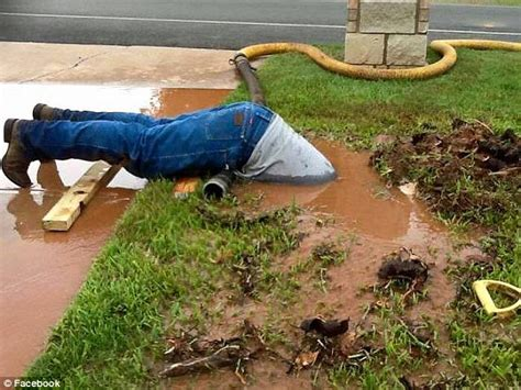 How To Fix A Backyard by Utility Worker Fixing A Leaking Pipe Sweeps The Daily Mail