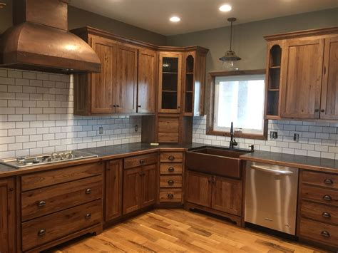 dark stained kitchen cabinets white subway tile dark grout with stained hickory cabinets copper sink and hood loving my new