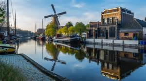 Harbor and windmill in gouda south holland the netherlands photo