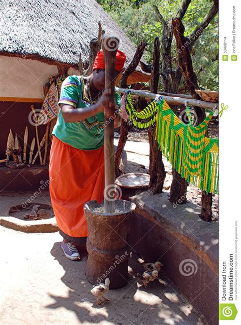south african house music 2008 african woman in multicolor dress cooking maize meal editorial stock image image
