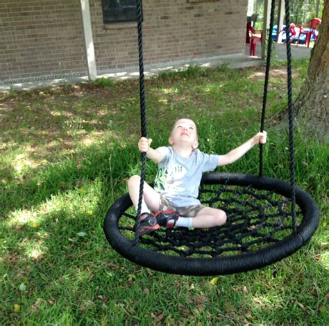 backyard swings for kids black color look like spider net model and round shaped
