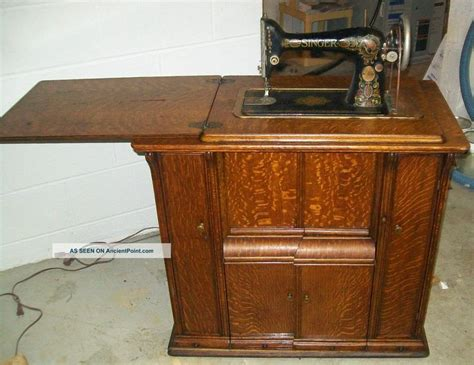 1920 singer sewing machine and cabinet model 66