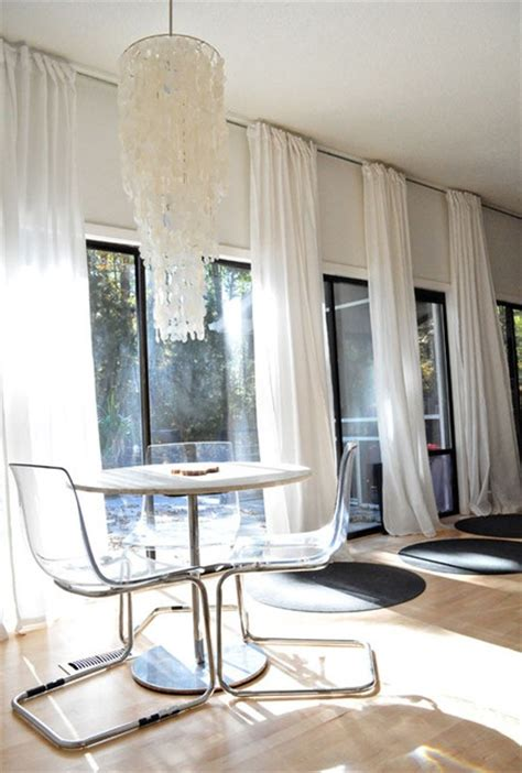 how to hang curtains from the ceiling how to enlarge a space progression by design