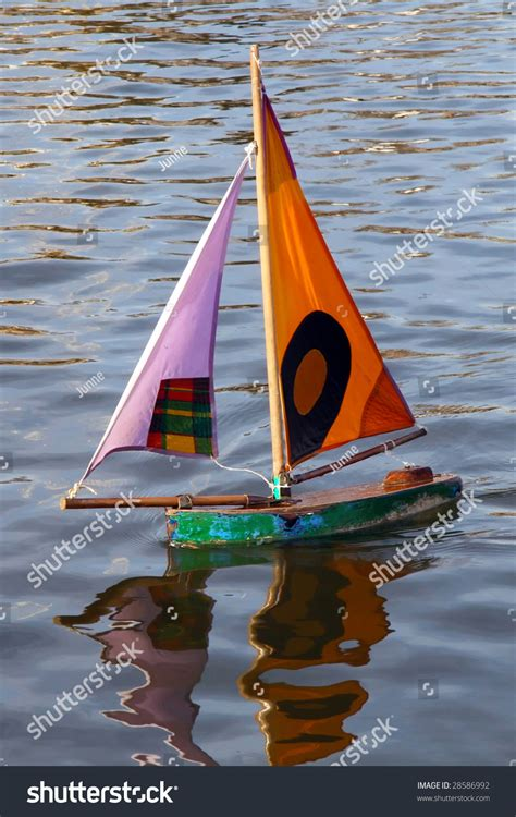 toy boat pic small toy boat in water stock photo 28586992 shutterstock