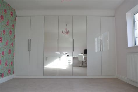 stylish bedroom with gloss white cabinet and custom made