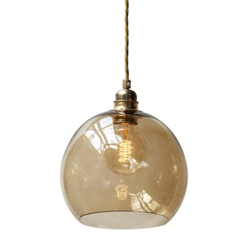 Globe Shaped Pendant Light Fitting Suspended On Long Brown Glass Pendant Lights
