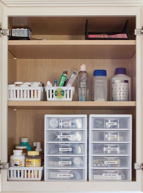 organize bathroom cabinet bathroom cabinet organization
