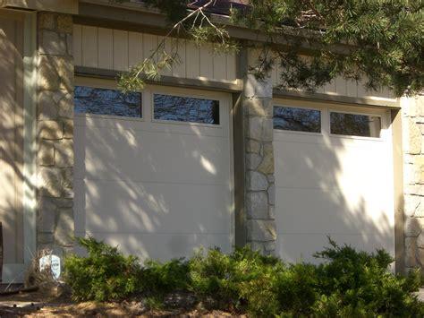 flush panel garage doors  windows st cloud mn adw