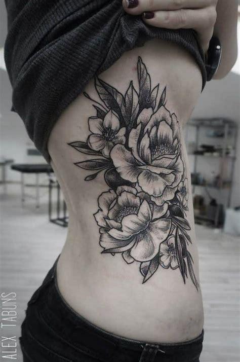 tattoo flower on side black ink peony flowers tattoo on right side rib