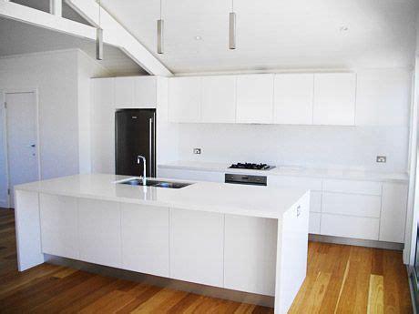 the granite gurus whiteout wednesday all white kitchen with a waterfall edge inspiring
