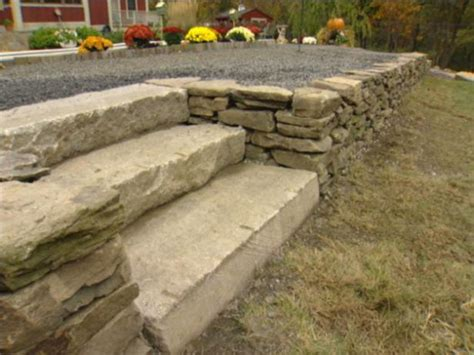 How To Build A Dry Stack Stone Retaining Wall How Tos Diy How To Build A Garden Wall On A Slope