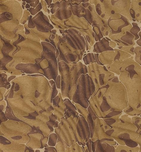 brown wave pattern vintage marbled paper in brown and amber spanish wave