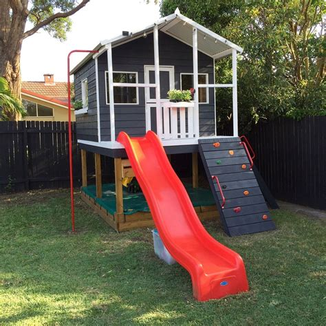 cubby house with swing and slide nov 18 how to design a family friendly garden playrooms