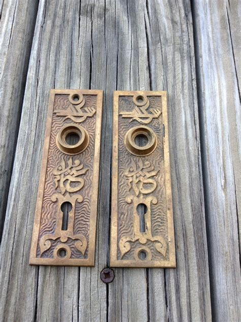 antique door knob plates with key brass by salvagenation