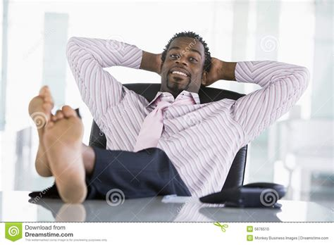 5 ft office desk businessman sitting in office with feet on desk stock