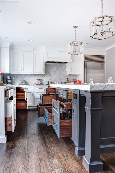 wrought iron kitchen island and white cabinets in towaco