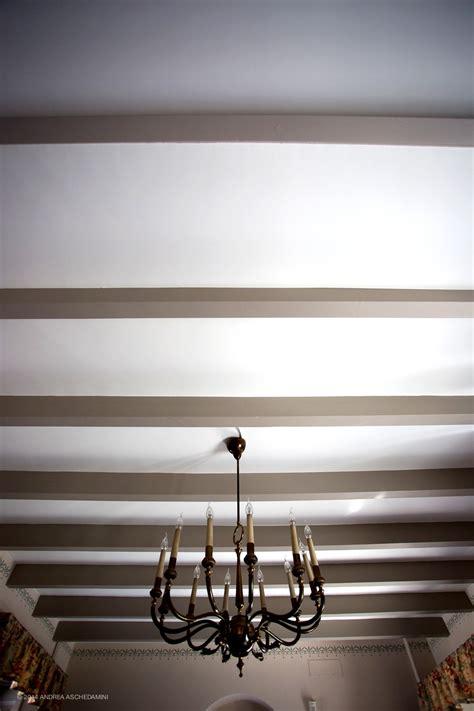 tinteggiatura soffitto con traversi legno
