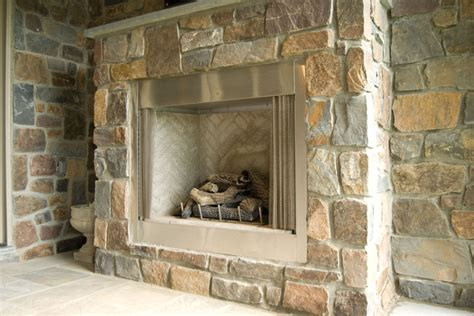 outdoor fireplace featuring thin veneers