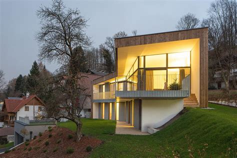 3 storey home on steep slope with grass roofed garage