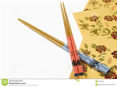 new year chopsticks and snake chopsticks with gold money wallets