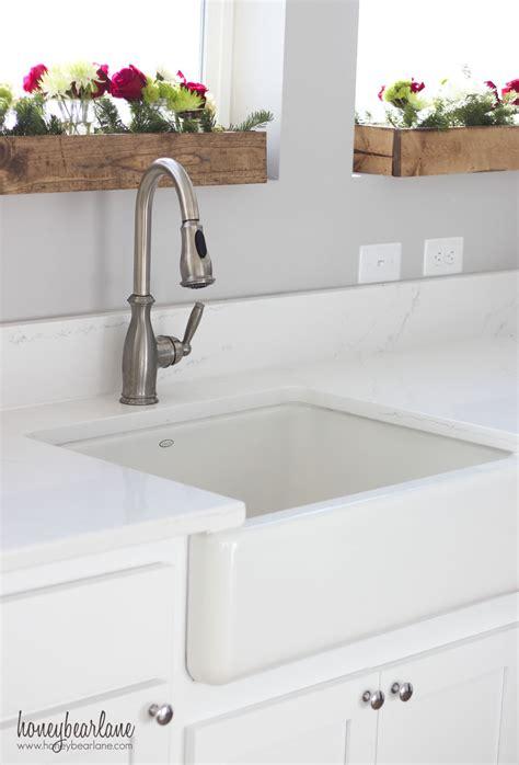 white farmhouse sink living with white honeybear